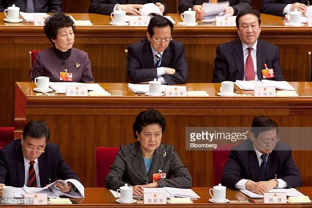 Wang Yang Chinese Communist Party secretary of Guangdong Province bottom row left Liu Yandong Chinese State Councilor bottom row center and Liu Qi...