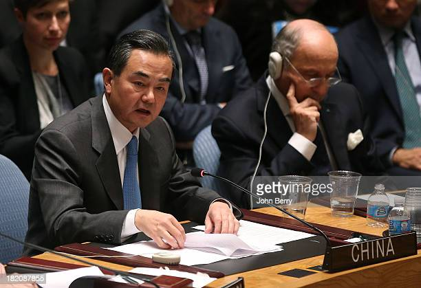 Wang Yi Minister for Foreign Affairs of China and Laurent Fabius Minister for Foreign Affairs of France vote on a resolution regarding Syria's...