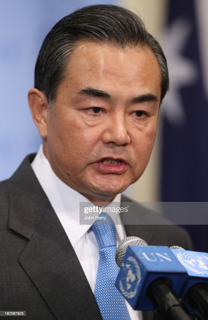 Wang Yi, Minister for Foreign Affairs of China votes on a resolution regarding Syria's chemical weapons program at a Security Council's meeting aside the 68th United Nations General Assembly on September 27, 2013 in New York City.