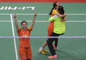 Wang Yihan and Wang Xiaoli of China celebrate after defating Miyuki Maeda and Reika Kakiiwa of Japan in the Uber Cup badminton final match at Siri...