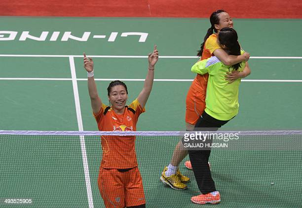 Wang Yihan and Wang Xiaoli of China celebrate after defating Miyuki Maeda and Reika Kakiiwa of Japan in the Uber Cup badminton final match at Siri...