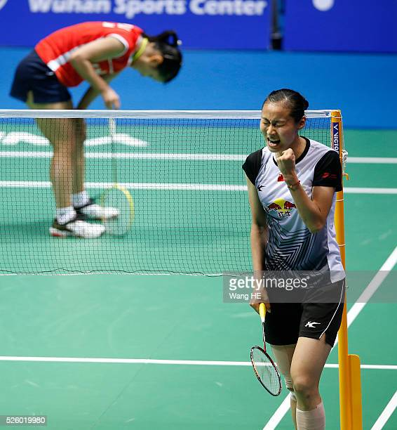 Wang Yihan of China celebrates after defeating Nozomi Okuhara of Japan during their women's singles match at the 2016 Badminton Asia Championships on...