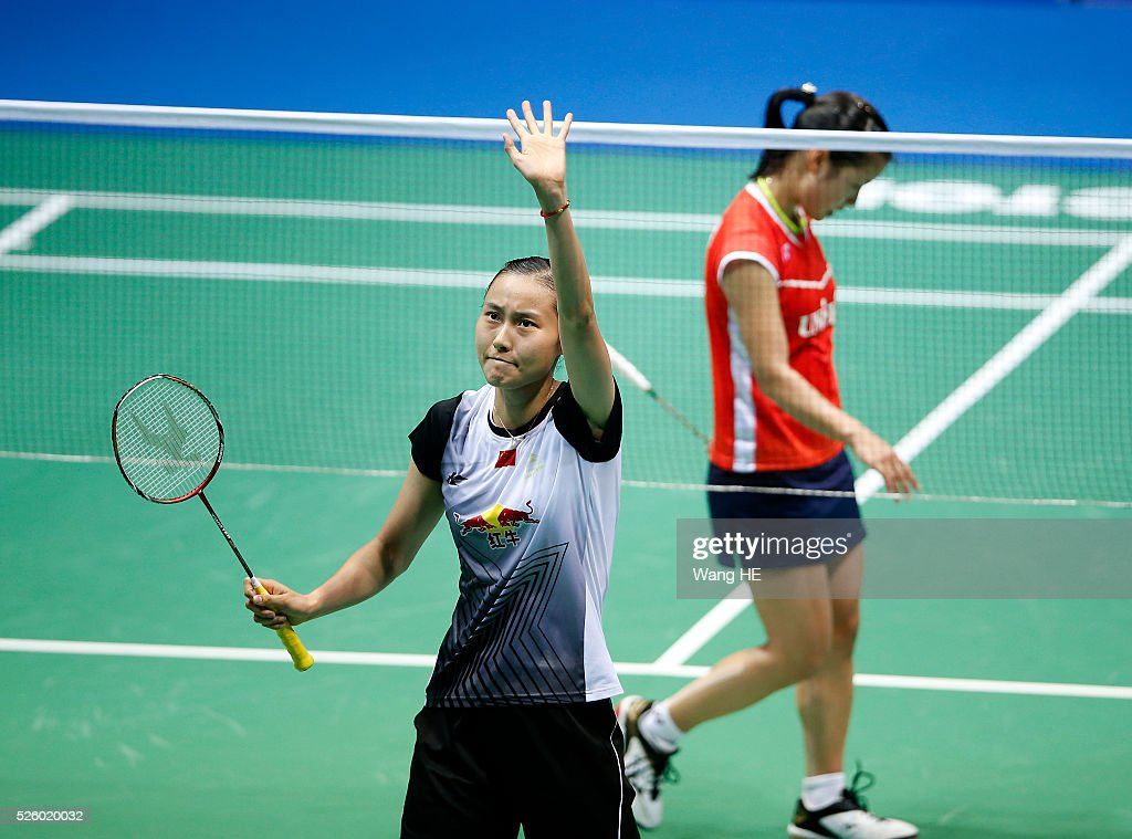 Wang Yihan of China celebrates after defeating Nozomi Okuhara of Japan during their women's singles match at the 2016 Badminton Asia Championships on April 29, 2016 in Wuhan, Hubei province, China.