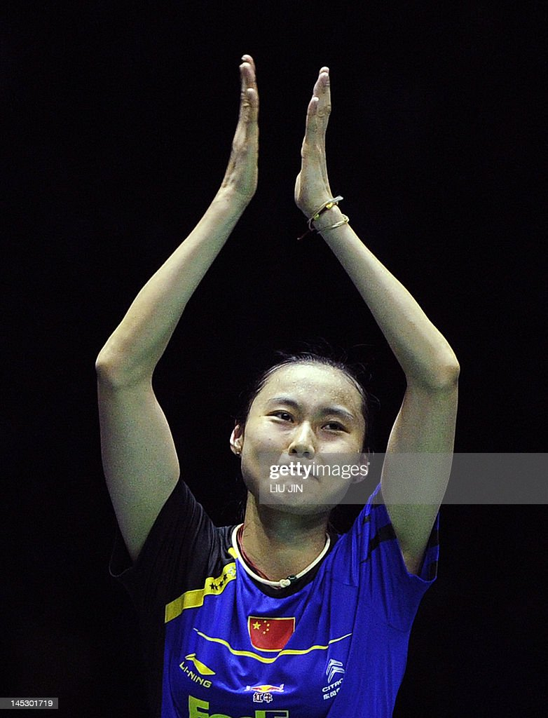 Wang Yihan of China celebrates her victo