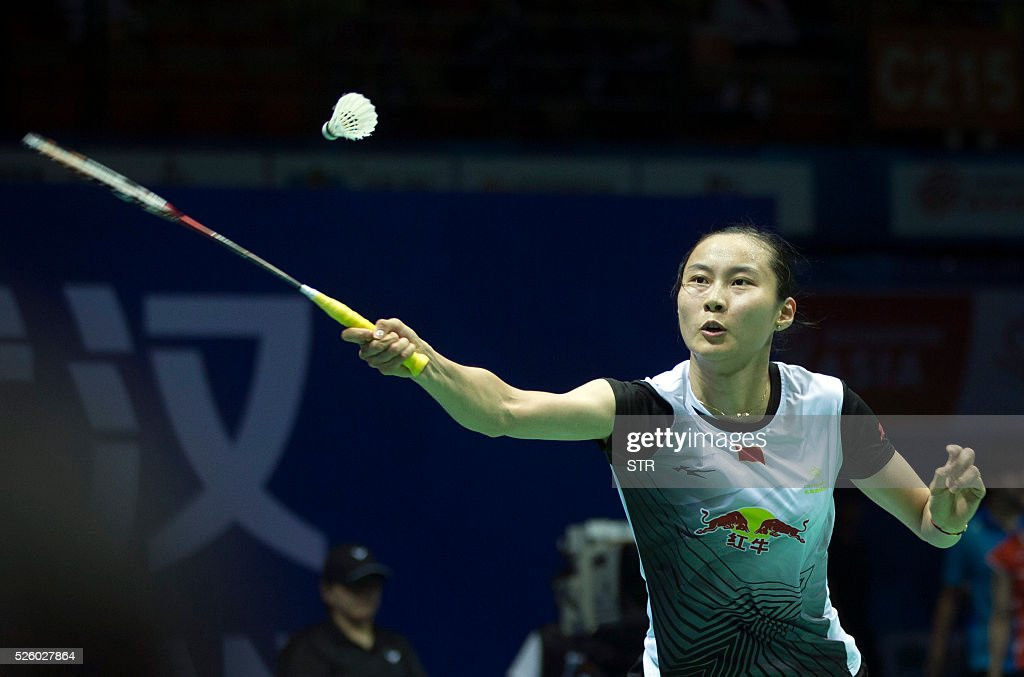 Wang Yihan of China hits a return against Nozomi Okuhara of Japan during the women's singles quarter-final match at the 2016 Badminton Asia Championships in Wuhan, central China's Hubei province on April 29, 2016. / AFP / STR
