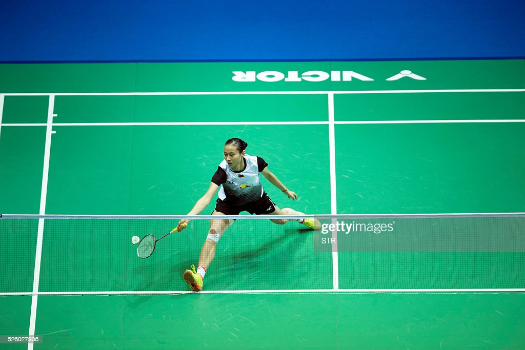 Wang Yihan of China hits a return against Nozomi Okuhara of Japan during their women's singles quarter-final match at the 2016 Badminton Asia Championships in Wuhan, central China's Hubei province on April 29, 2016. / AFP / STR