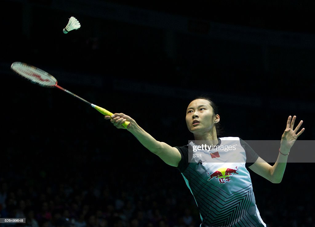 Wang Yihan of China hits a return to Saina Nehwal of India during their women's singles semi-final match at the 2016 Badminton Asia Championships in Wuhan, central China's Hubei province on April 30, 2016. / AFP / STR
