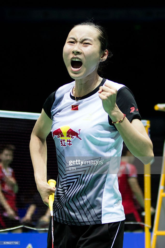 Wang Yihan of China reacts during the women's singles quarter-final match against Nozomi Okuhara of Japan at the 2016 Badminton Asia Championships in Wuhan, central China's Hubei province on April 29, 2016. / AFP / STR
