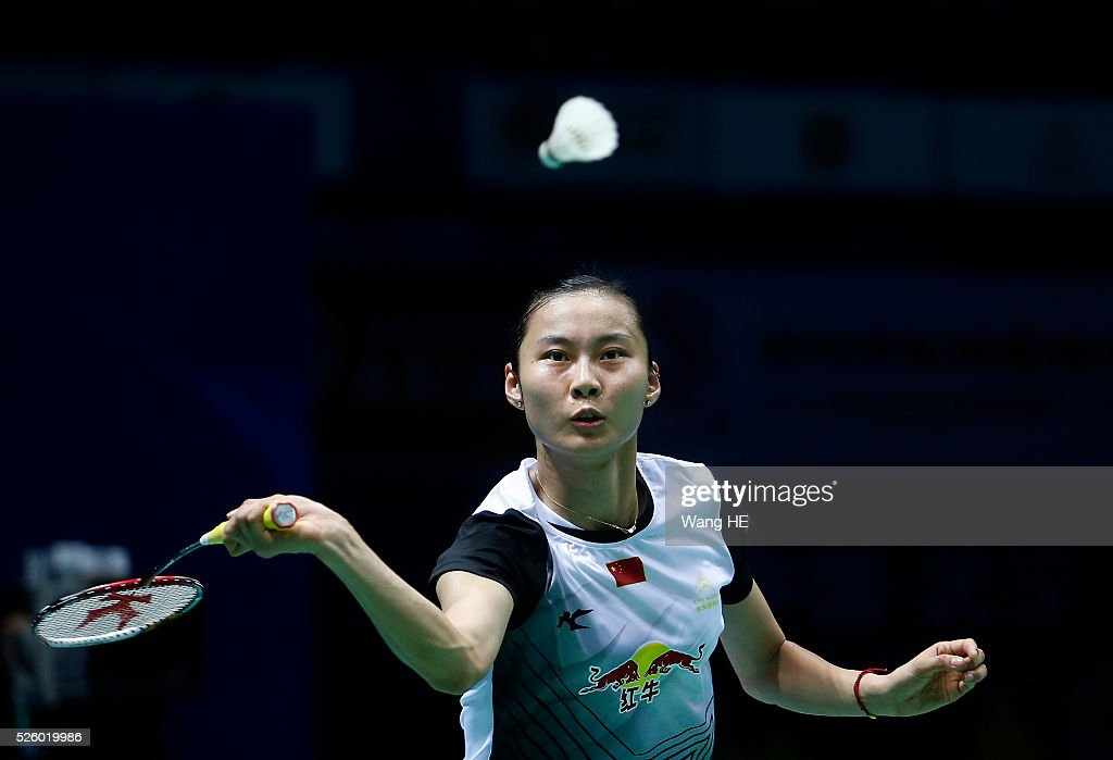 Wang Yihan of China returns a shot to Nozomi Okuhara of Japan during their women's singles match at the 2016 Badminton Asia Championships on April 29, 2016 in Wuhan, Hubei province, China.
