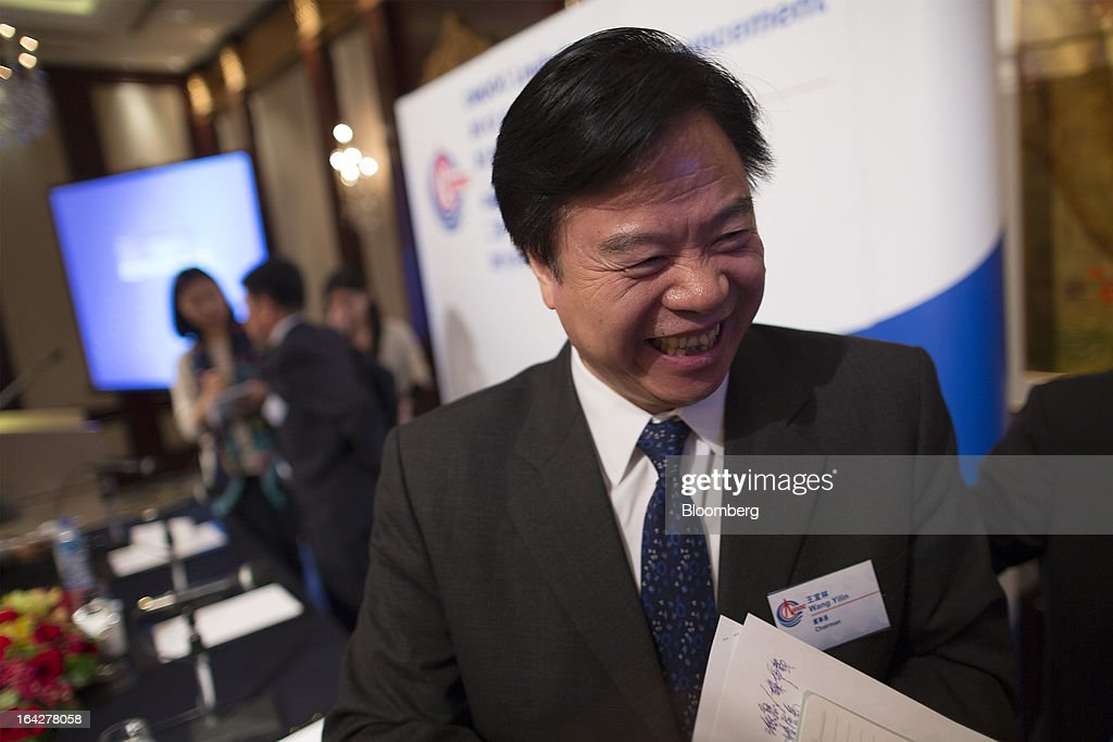 Wang Yilin, chairman of Cnooc Ltd., reacts as he leaves a news conference in Hong Kong, China, on Friday, March 22, 2013. Cnooc reported 2012 profit that missed analyst estimates as China's biggest offshore oil producer spent more to explore and revive stalled output growth. Photographer: Jerome Favre/Bloomberg via Getty Images