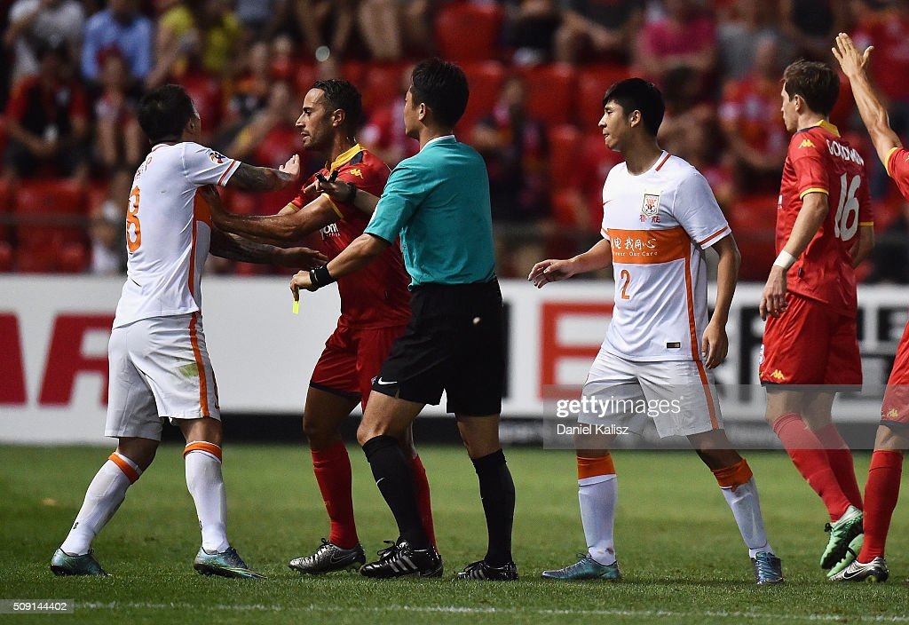 Wang Yongpo of Shandong Luneng and Tarek Elrich of United react during the AFC Champions League playoff match between Adelaide United and Shandong Luneng at Coopers Stadium on February 9, 2016 in Adelaide, Australia.
