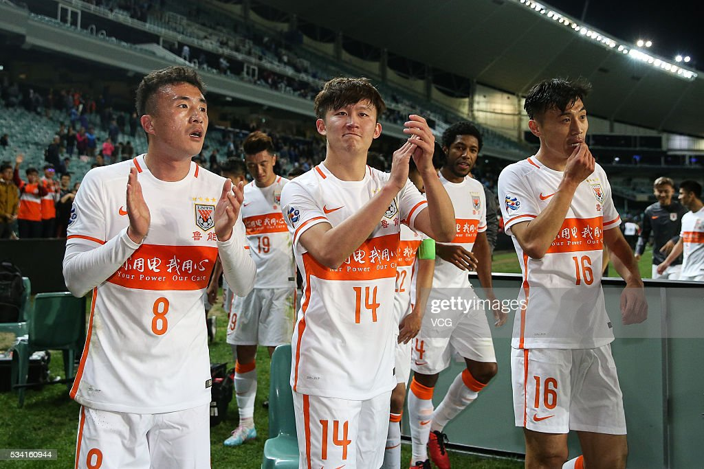 Wang Yongpo #8, Wang Tong #14 and Zheng Zheng #16 of Shandong Luneng celebrates at the conclusion of the 1/8 match of AFC Champions League between Sydney and Shandong Luneng at Allianz Stadium on May 24, 2016 in Sydney, Australia.