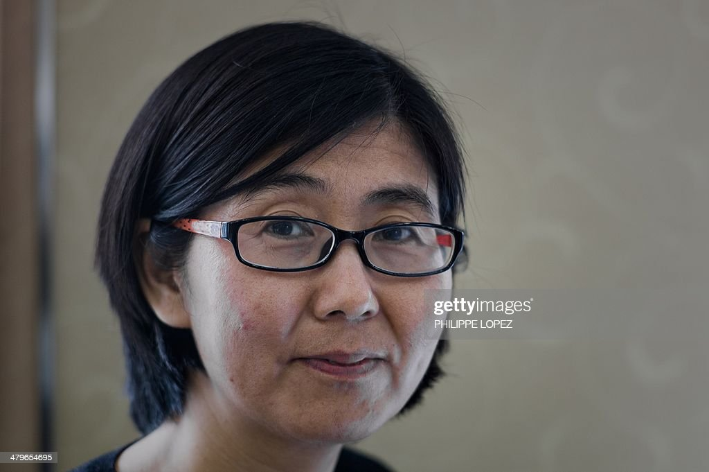 Wang Yu, the lawyer of late Chinese human rights activist Cao Shunli, poses during an interview in Hong Kong on March 20, 2014. The 52-year-old Cao, who died in police detention on March 14, 2014 in Beijing, was said to have dark marks all over her body, her lawyer disclosed, citing Cao's relatives. Cao was set to travel to Switzerland to take part in a UN Human Rights Council review last September but police detained her at Beijing's international airport, her lawyer Wang Yu told AFP on March 14. AFP PHOTO / Philippe Lopez