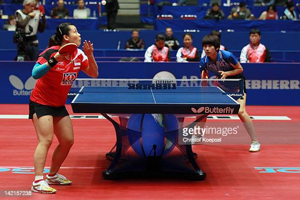 Wang Yuegu of Singapore serves during her match against Seok Ha Jung of South Korea during the LIEBHERR table tennis team world cup 2012 championship...