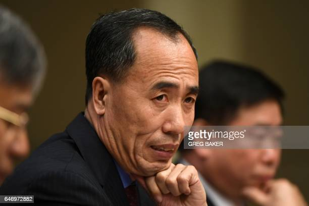 Wang Zhaoxing Vice Chairman of the China Banking Regulatory Commission listens to a question at a press conference in Beijing on March 2 2017 / AFP...