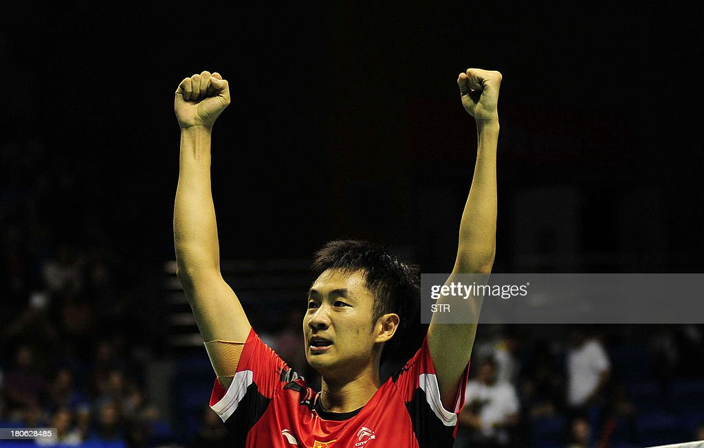 Wang Zhengming of China celebrates after beating Son Wan Ho of South Korea in the men's singles final match of the 2013 China Masters in Changzhou, east China's Jiangsu province on September 15, 2013. Wang won 11-21, 21-14, 24-22. CHINA