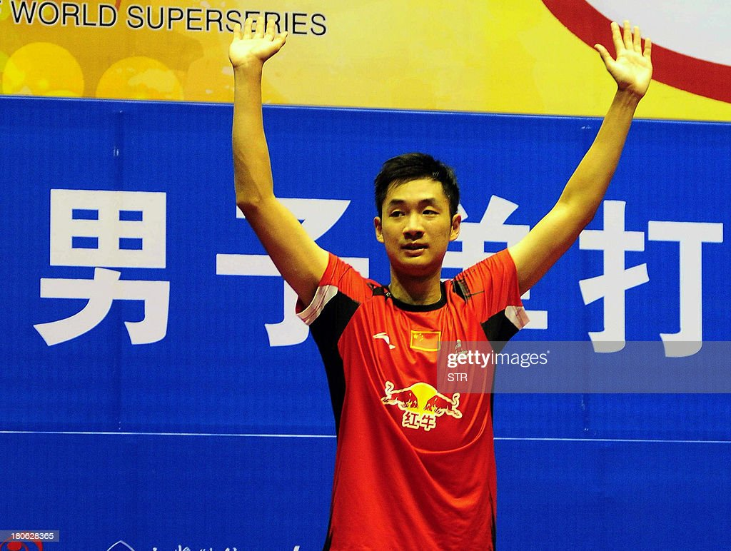 Wang Zhengming of China celebrates during the award ceremony after beating Son Wan Ho of South Korea in the men's singles final match of the 2013 China Masters in Changzhou, east China's Jiangsu province on September 15, 2013. Wang won 11-21, 21-14, 24-22. CHINA