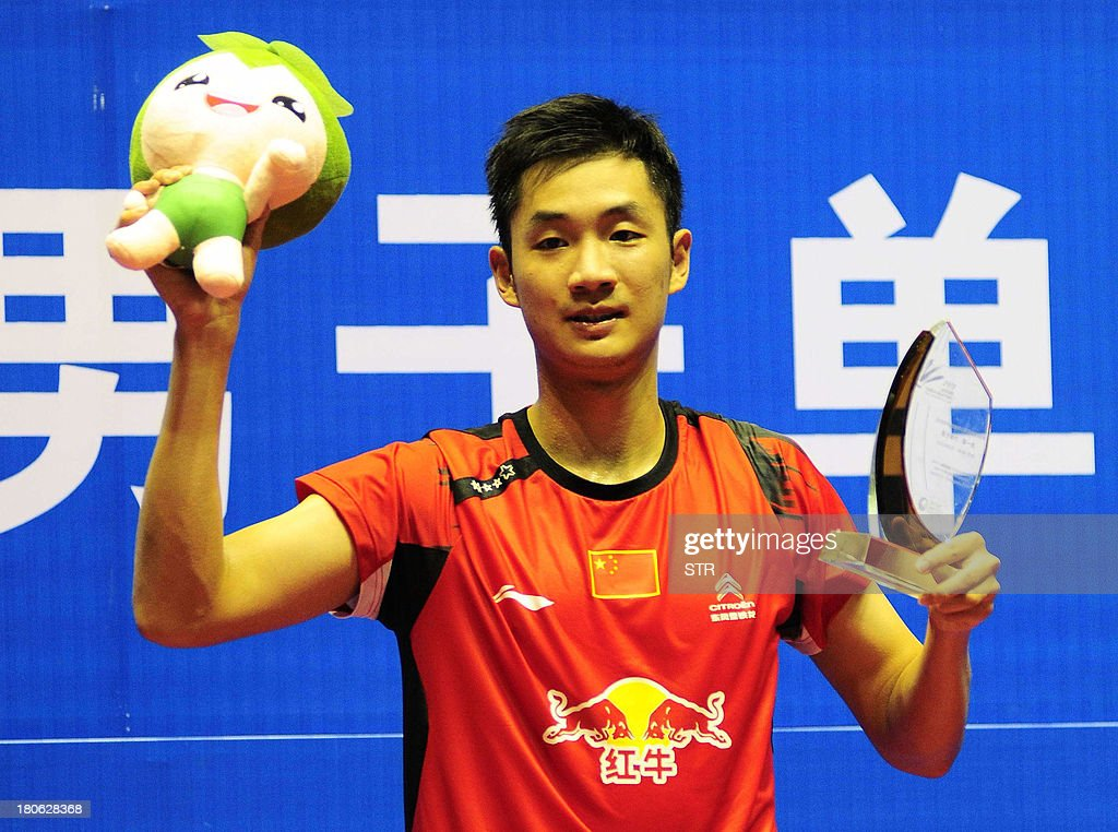 Wang Zhengming of China poses with the trophy during the award ceremony after beating Son Wan Ho of South Korea in the men's singles final match of the 2013 China Masters in Changzhou, east China's Jiangsu province on September 15, 2013. Wang won 11-21, 21-14, 24-22. CHINA OUT AFP PHOTO