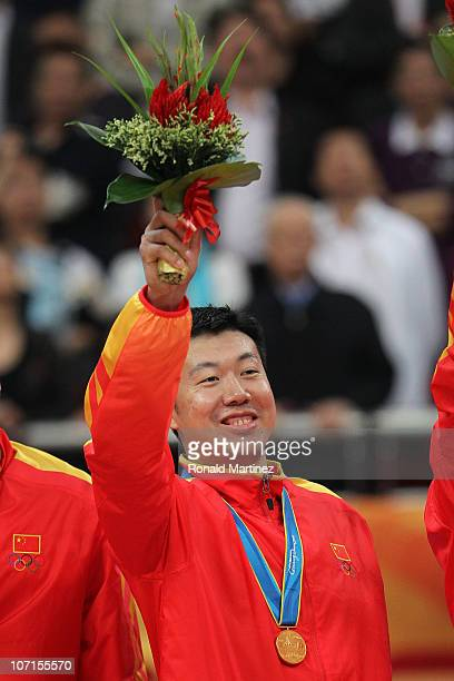 Wang Zhizhi of China celebrates after China wins the gold medal by defeating South Korea 7771 in the men's gold medal basketball game at the...