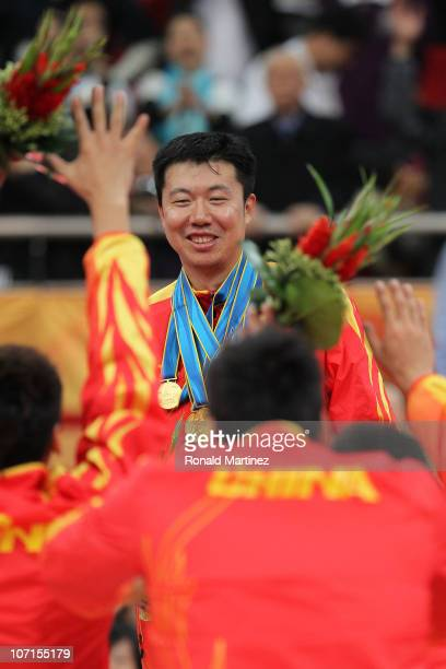 Wang Zhizhi of China is given all the medals as by his teammates as they bow to him after China wins the gold medal by defeating South Korea 7771 in...