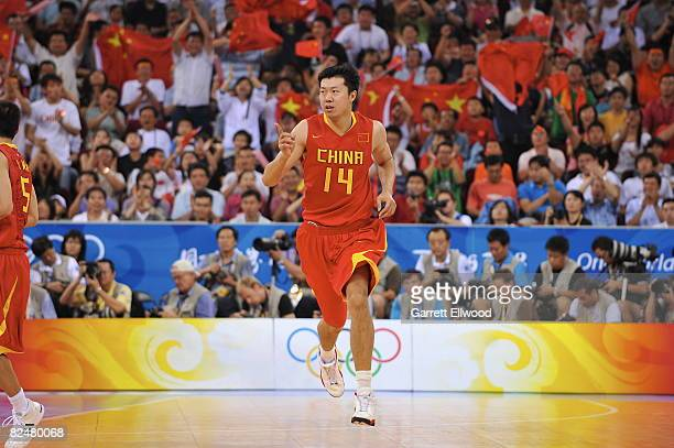 Wang Zhizhi of China runs upcourt against Lithuania during the men's quarterfinals basketball game at the 2008 Beijing Olympic Games at the Beijing...