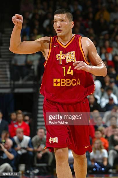 Wang Zhizhi of the China Men's World Championship Team runs up court against the USA Basketball Men's Championship Team at The Arena in Oakland...