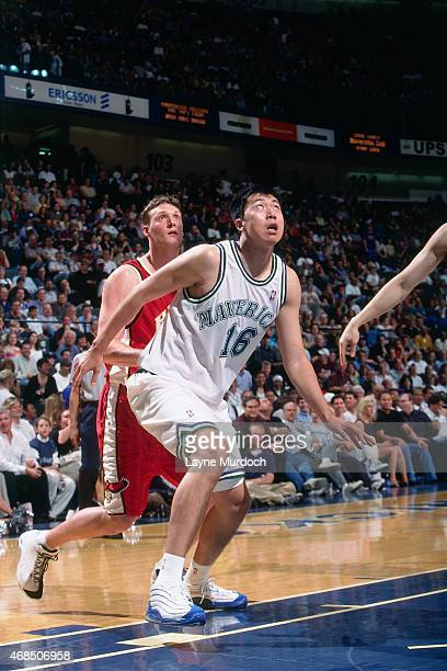Wang ZhiZhi of the Dallas Mavericks boxes out against the Atlanta Hawks on April 5 2001 at American Airlines Arena in Dallas Texas Wang ZhiZhi is the...