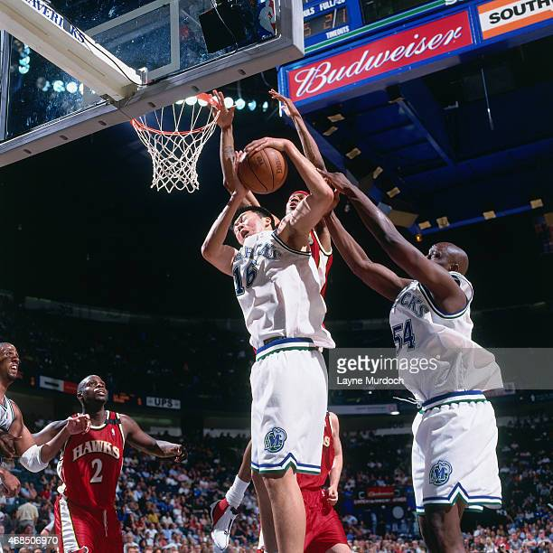 Wang ZhiZhi of the Dallas Mavericks rebounds against the Atlanta Hawks on April 5 2001 at American Airlines Arena in Dallas Texas Wang ZhiZhi is the...