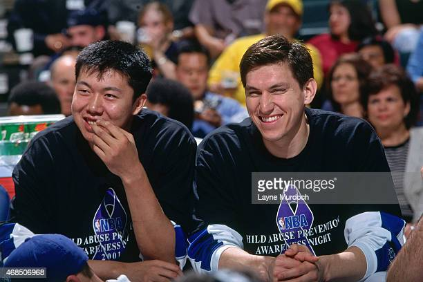 Wang ZhiZhi of the Dallas Mavericks sits on the bench against the Atlanta Hawks on April 5 2001 at American Airlines Arena in Dallas Texas Wang...