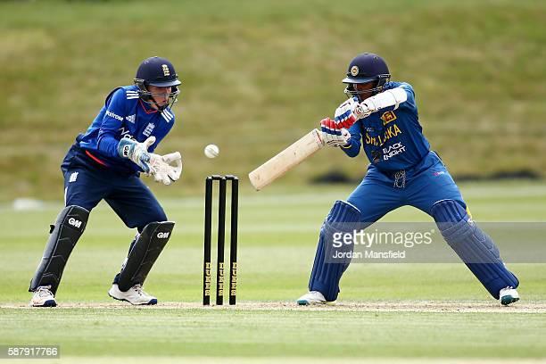 Wanidu Hasaranga of Sri Lanka hits out past Ollie Pope of England during the Royal London OneDay Series match between England U19 v Sri Lanka U19 at...