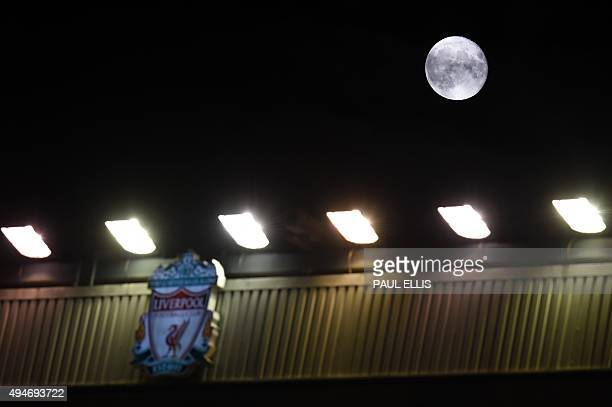 A waning new moon is pictured in the night's sky above the Liverpool logo at the Anfield stadium during the English League Cup fourth round football...