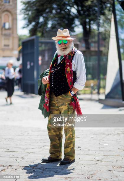 Wanny Antonio Di Filippo wearing camouflage pants vest hat is seen during Pitti Immagine Uomo 92 at Fortezza Da Basso on June 15 2017 in Florence...