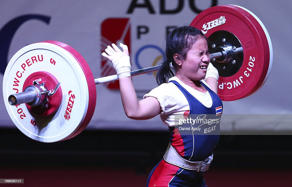 Wanroek On-uma of Thailand B competes in the Women's 48kg during day one of the 2013 Junior Weightlifting World Championship at Maria Angola Convention Center on April 04, 2013 in Lima, Peru.