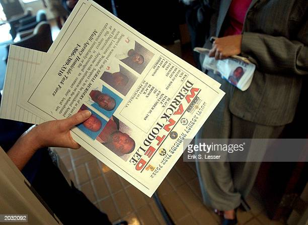 Wanted fliers for serial murder suspect Derrick Todd Lee are handed out before a news conference at Georgia Bureau of Investigation headquarters May...