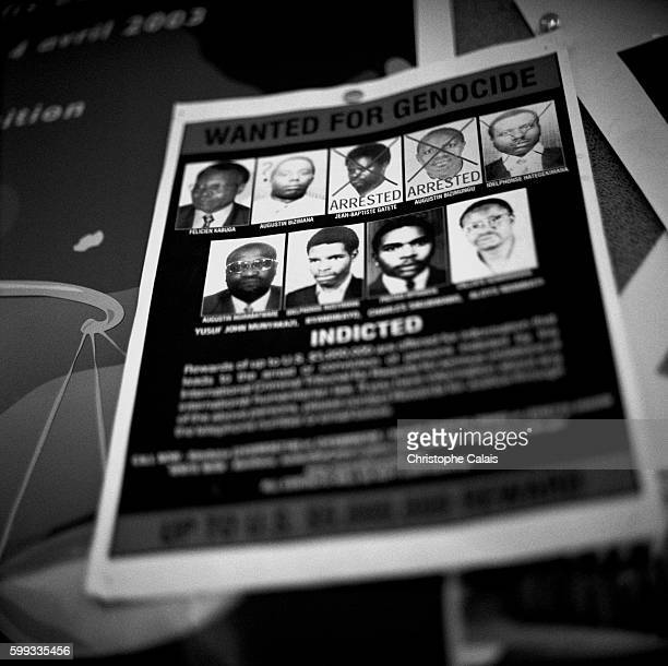 Wanted poster with portraits of those accused of perpetrating genocide with a bounty of 500000 US dollars per head