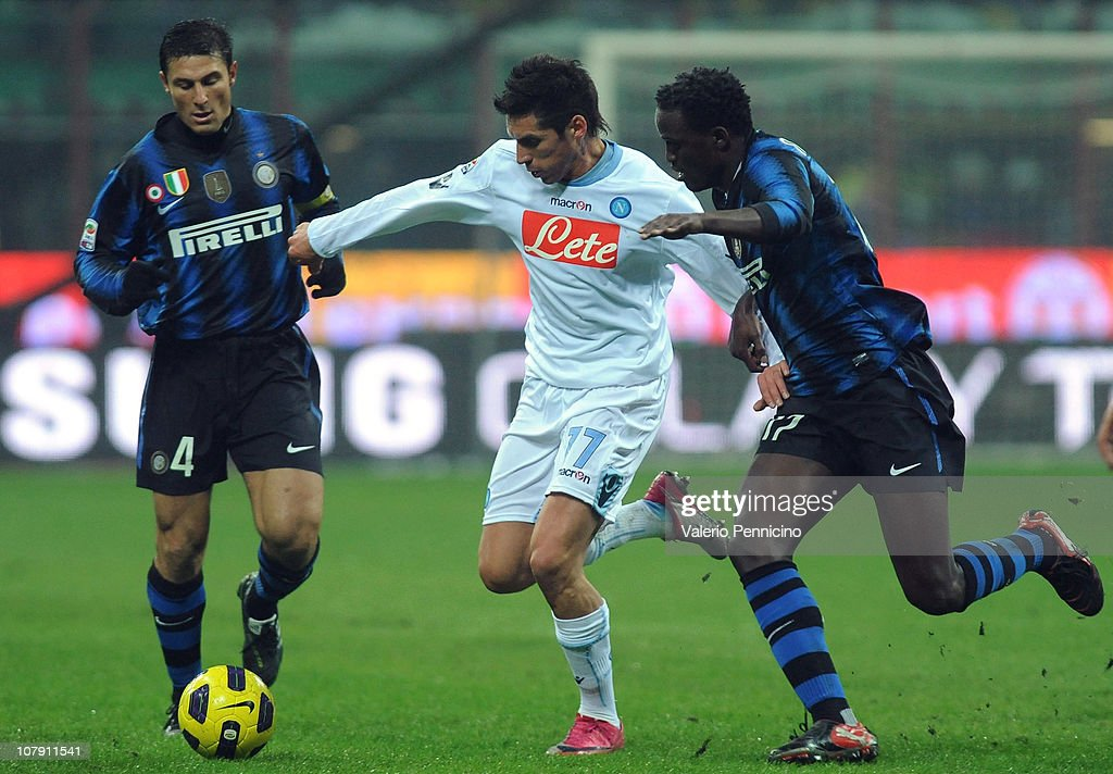 Wanyama Mariga of FC Internazionale Milano competes for the ball with Jose Ernesto Sosa of SSC Napoli during the Serie A match between FC...