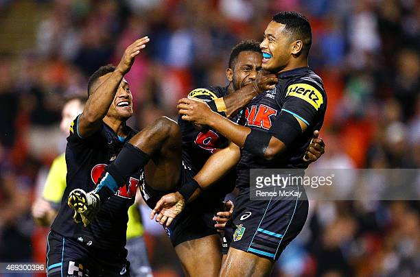 Waqa Blake of the Panthers celebrates his try with team mates Apisai Koroisau and James Segeyaro during the round six NRL match between the Penrith...