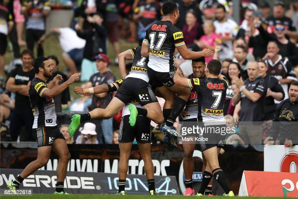 Waqa Blake of the Panthers celebrates with his team mates after scoring a try during the round 10 NRL match between the Penrith Panthers and the New...