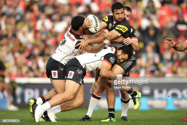 Waqa Blake of the Panthers is tackled during the round 10 NRL match between the Penrith Panthers and the New Zealand Warriors at Pepper Stadium on...