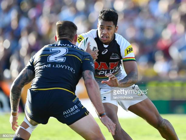 Waqa Blake of the Panthers looks to get past Kyle Feldt of the Cowboys during the round 16 NRL match between the North Queensland Cowboys and the...