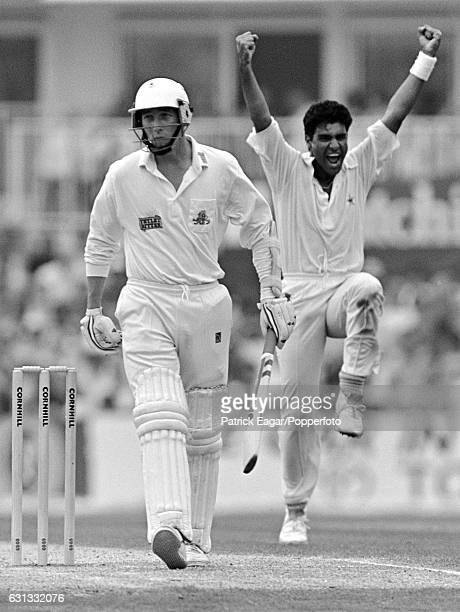 Waqar Younis of Pakistan celebrates after dismissing England batsman Mike Atherton for 4 runs during the 5th Test match between England and Pakistan...