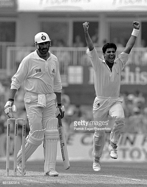 Waqar Younis of Pakistan celebrates after dismissing England batsman Graham Gooch for 24 runs during the 5th Test match between England and Pakistan...