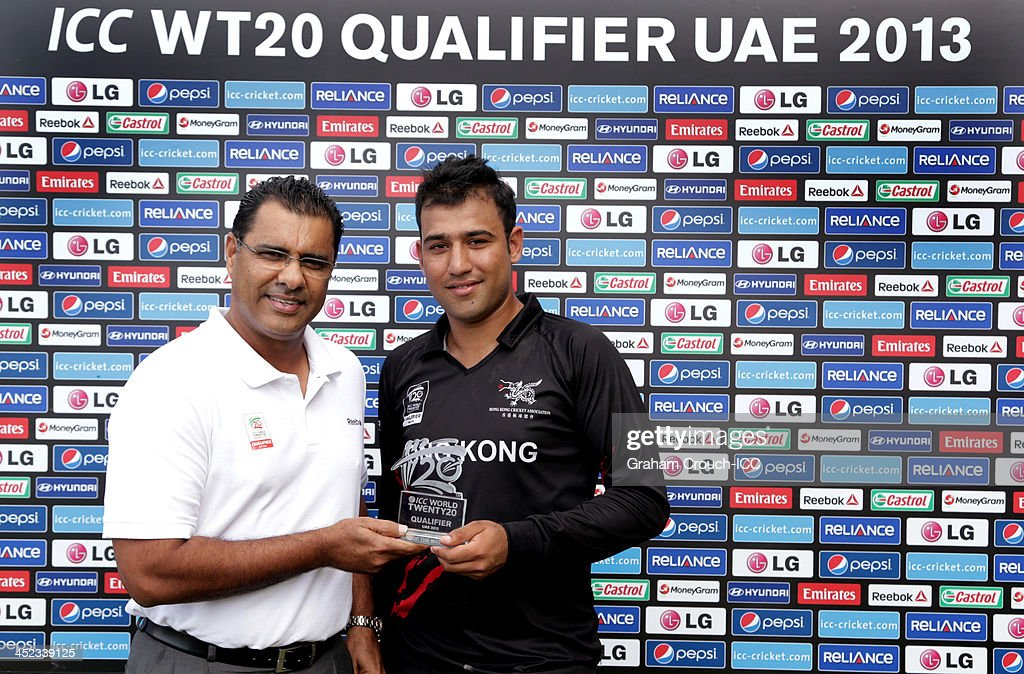 <a gi-track='captionPersonalityLinkClicked' href=/galleries/search?phrase=Waqar+Younis&family=editorial&specificpeople=226693 ng-click='$event.stopPropagation()'>Waqar Younis</a> presents Babar Hayat of Hong Kong with the man of the match award during of the Papua New Guinea v Hong Kong Quarter Final match at the ICC World Twenty20 Qualifiers at the Zayed Cricket Stadium on November 28, 2013 in Abu Dhabi, United Arab Emirates.