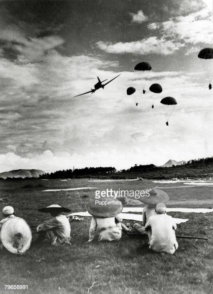 War and Conflict 2nd SinoJapanese War pic 1944 An American aircraft continues on it's flight after dropping ammunition by parachutes to waiting...