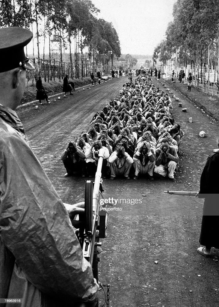 1954, Armed guards for Mau Mau rebel suspects during the troubles in Kenya, The rebels waged a war of murder against the colonial rule of Great Britain in the country