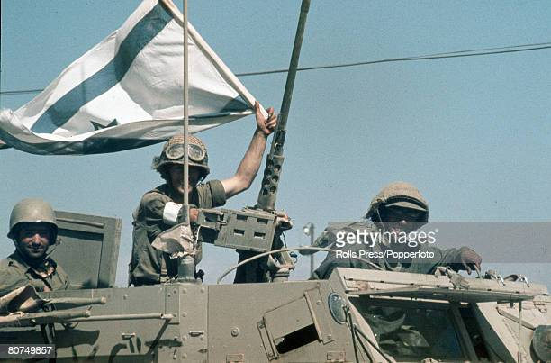War and Conflict Middle East Yom Kippur War pic October 1973 Victorious Israeli soldiers wave their national flag from an armoured personnel carrier...