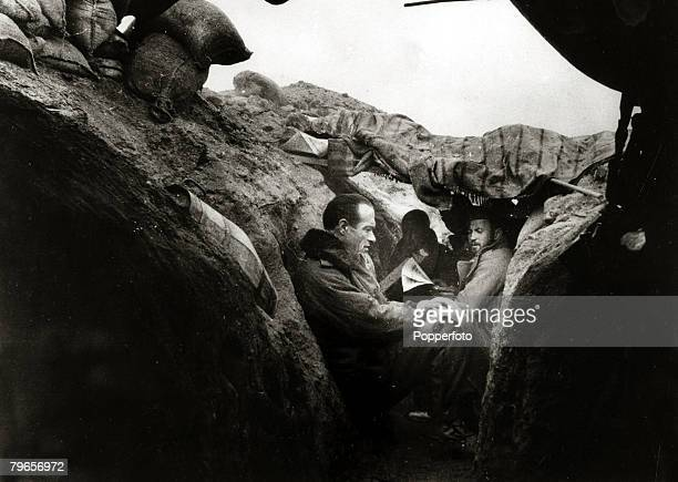 War and Conflict Spanish Civil War pic 29th December 1936 Insurgent soldiers sit against the narrow walls of a trench on the Madrid front With what...