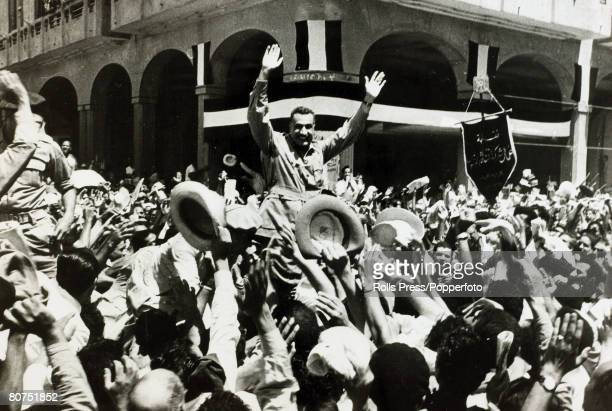 1956 Egyptian Prime Minister Gamel Abdel Nasser is carried through the streets of Port Said after the British evacuation