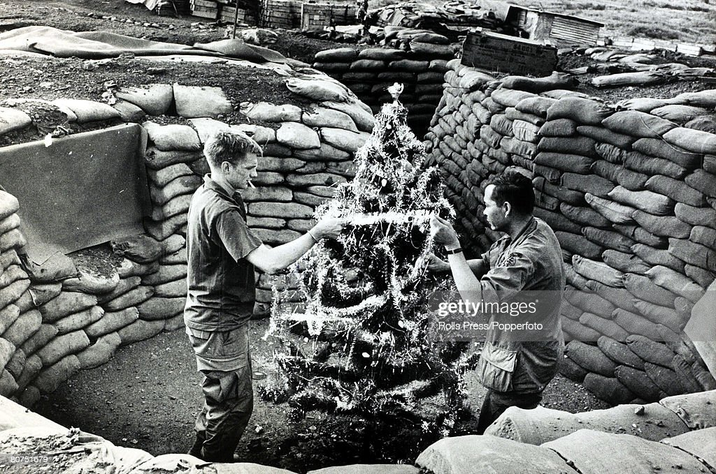 War and Conflict, The Vietnam War, Duc Lap, South Vietnam, pic: December 1969, Two American soldiers prepare a christmas tree in a sandbagged trench system