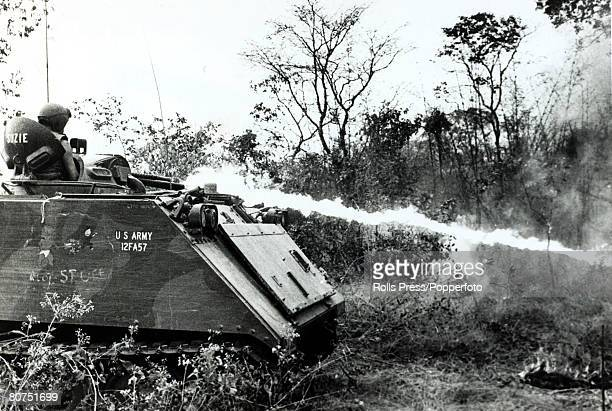 War and Conflict The Vietnam War near the 'Iron Triangle' South Vietnam pic January 1967 An American flamethrower tank sprays Viet Cong positions to...